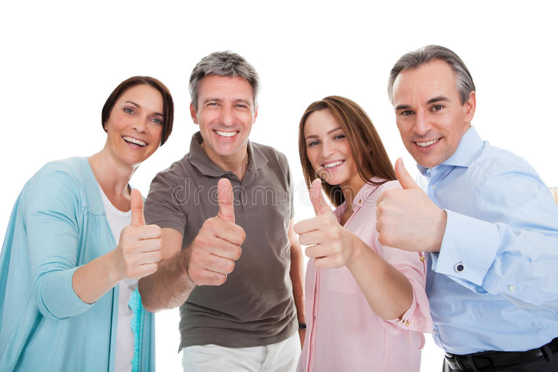 Group of happy people showing thumb up sign stock photo