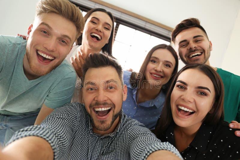 Group of happy people taking selfie royalty free stock image