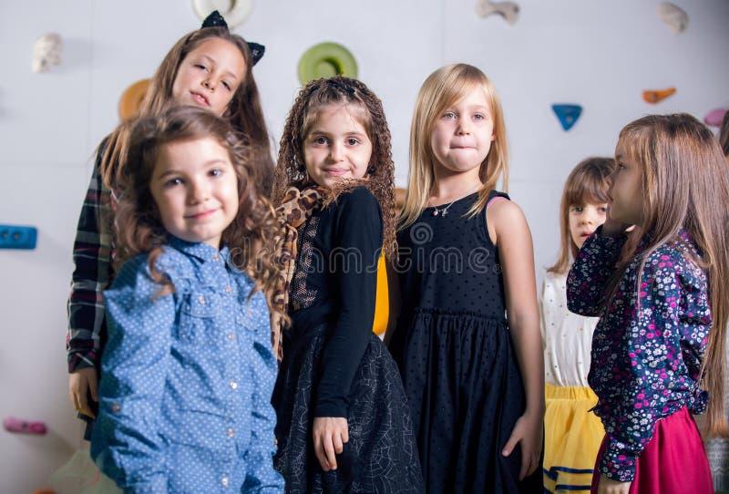 Group of happy preschoolers dancing in playroom stock photo