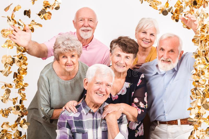 Group of senior people celebrating and having fun together stock photo