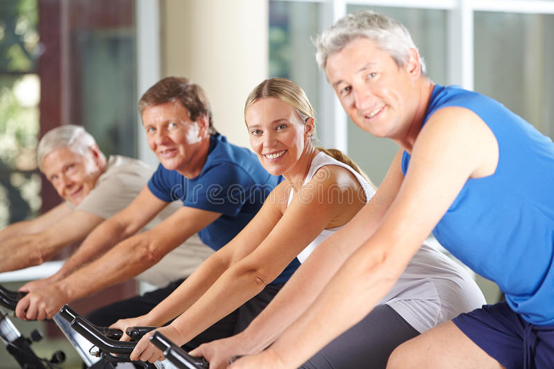 Group of happy seniors spinning royalty free stock image