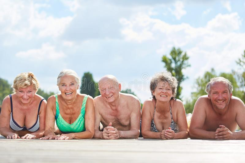 Group of happy seniors in the sun. Group of happy seniors in summer on vacation is lying relaxed in the sun royalty free stock photos