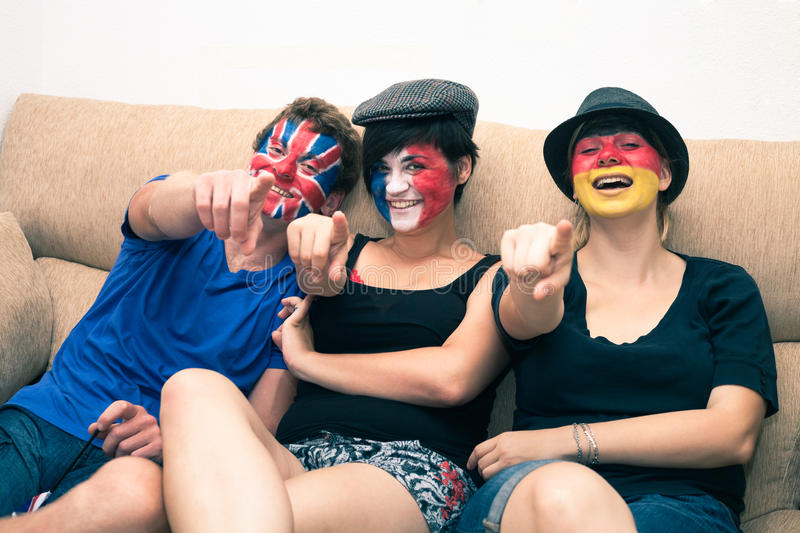 Group of happy sports fans pointing stock photography