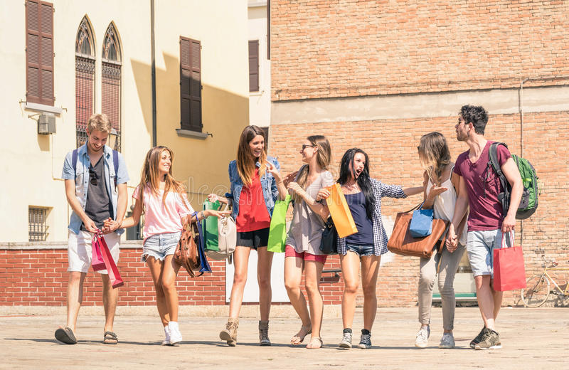 Group of happy students best friends with shopping bags stock photography