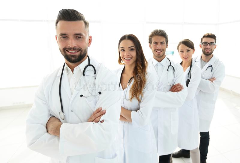 Group of happy successful doctors standing in a row in the hospital royalty free stock image