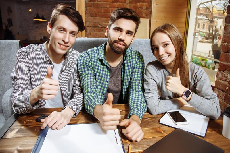 Group of happy successful young people showing thumb up. royalty free stock photography