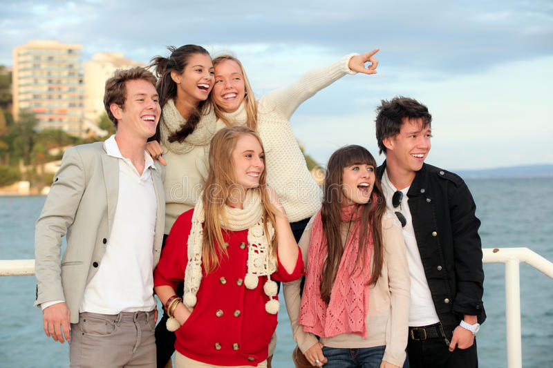 Group happy surprised teens. Group of happy surprised teens or young people pointing and smiling stock photo