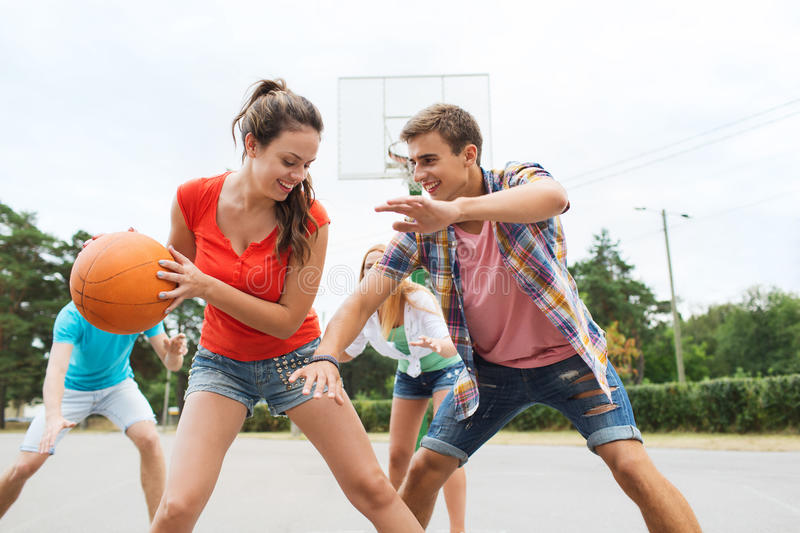 A Woman Playing Basketball Imágenes De Stock A Woman: Group Of Happy Teenagers Playing Basketball Stock Image