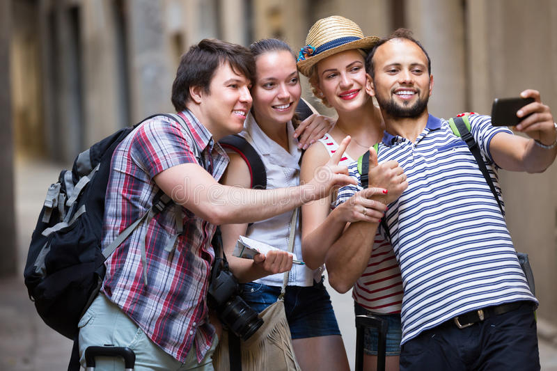 Group of happy tourist doing selfie stock photography
