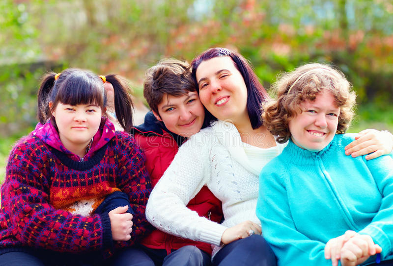 Group of happy women with disability having fun in spring park. Portrait of happy women with disability having fun in spring park royalty free stock image