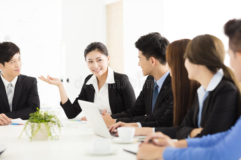 Group of happy young business people in meeting stock photography