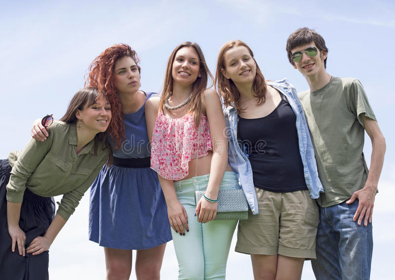 Group of happy young college students having fun royalty free stock photos