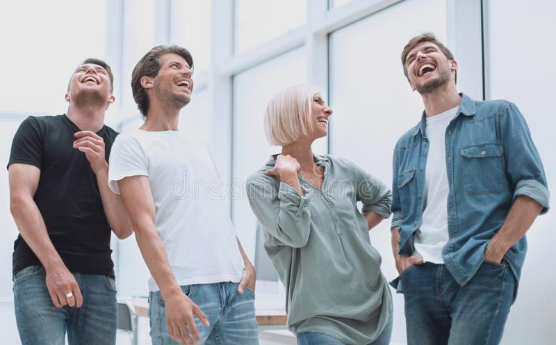 Group of happy young employees standing in the office stock image