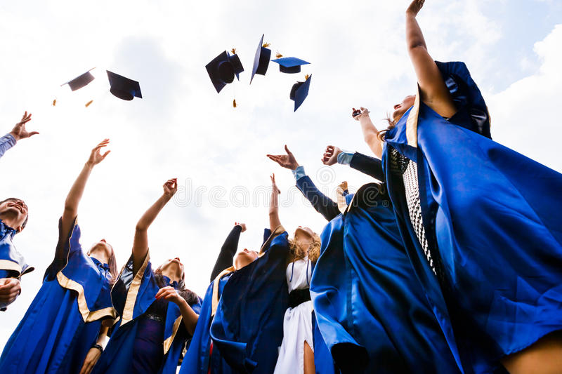 Group of happy young graduates stock photos