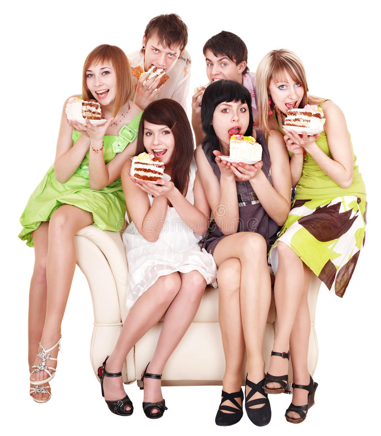 Group of happy young people with cake. stock photo