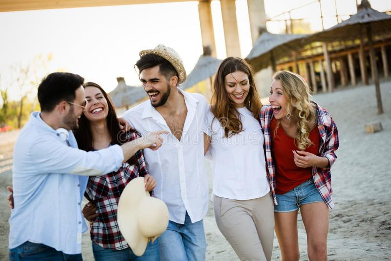 Group of happy young people enjoying summer vacation royalty free stock photography