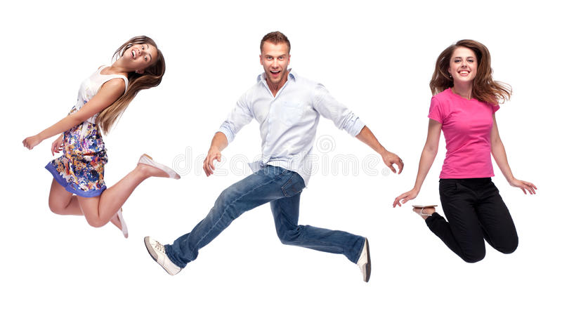 Group of happy young people jumping stock photo
