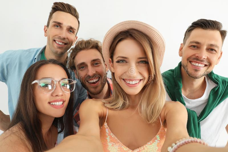 Group of happy young people taking selfie. On white background royalty free stock photo
