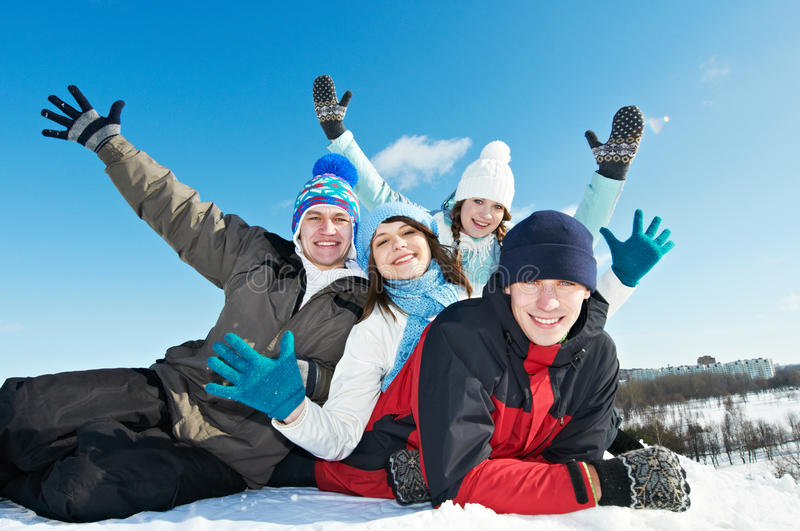 Group of happy young people in winter royalty free stock photography