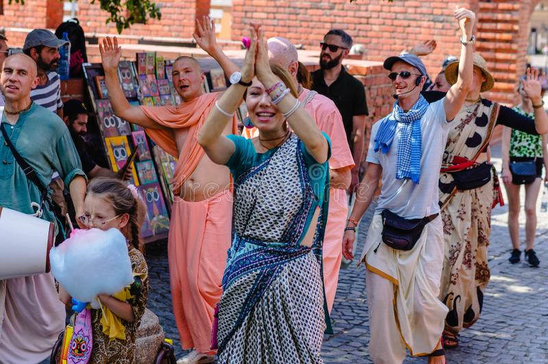 A group of Hare Krishnas in Krakov.  : Krakow, Poland - August 28, 2019.  stock photos