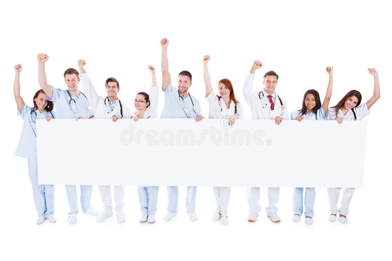 Group of healthcare personnel holding a banner stock photography