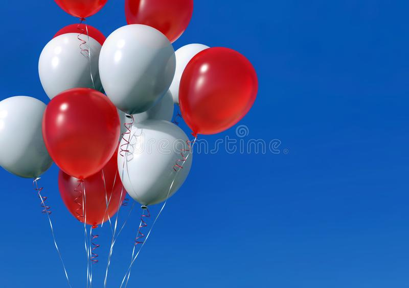 Group of helium balloons with ribbons on blue sky background stock photo