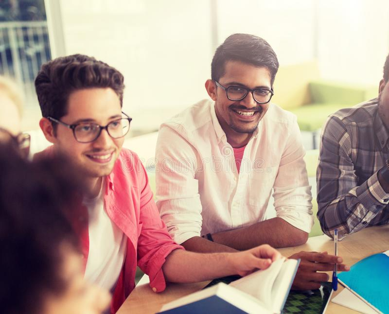 Group of high school students sitting at table royalty free stock photo