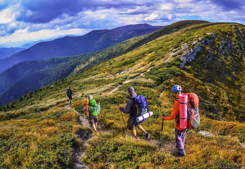Group of hikers in the mountains, view of Carpathians mountains. In Ukraine stock photography