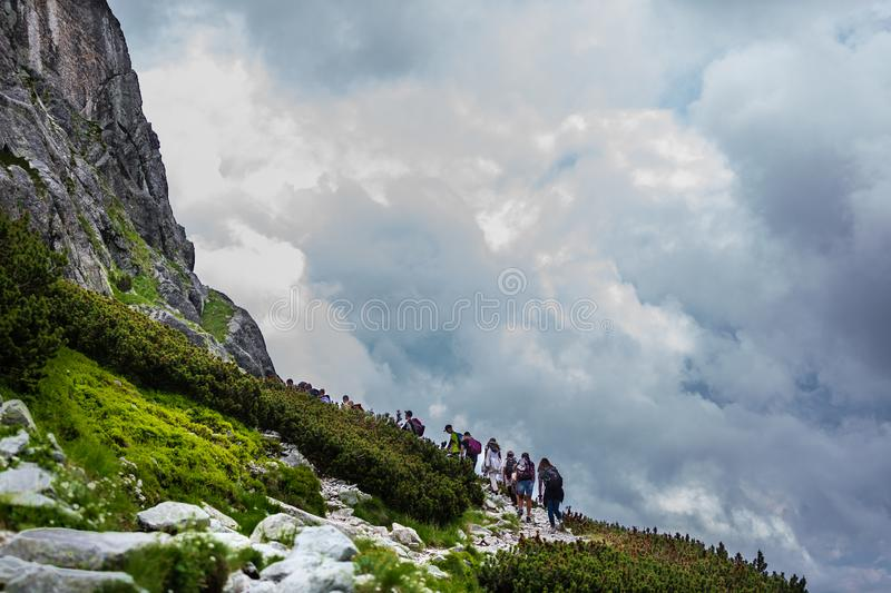 Group of hikers on a path to High Tatras mountains royalty free stock photo