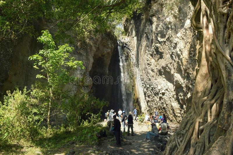 Tululusia waterfall, Arusha National Park, Tanzania. A group of hikers at Tululusia Waterfall in Arusha National Park, Tanzania royalty free stock photo