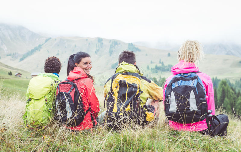 Group of hikers watching the scene in the fog. stock images