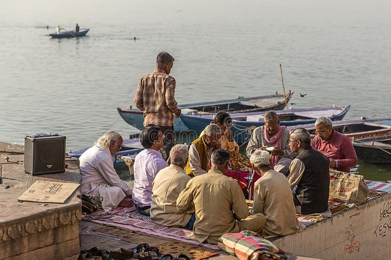 A group of Hindu chanting. Every morning, along the Ganges river in Varanasi, India, many Hindus gather to chant prayers royalty free stock images