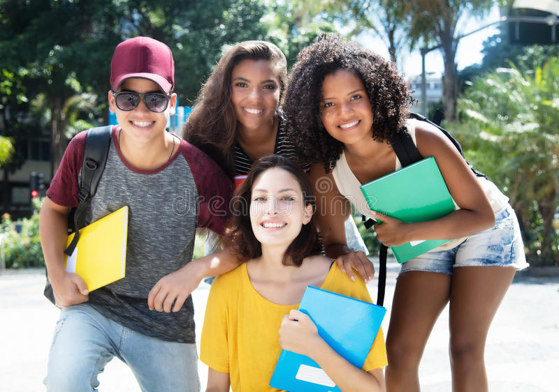 Group of hip multi ethnic brazilian students. Outdoor in the city in the summer stock image