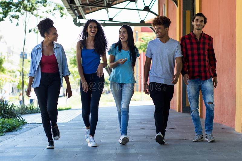 Group of hispanic and african american hipster young adults in city. Group of hispanic and african american hipster young adults outdoor in city in summer royalty free stock photo