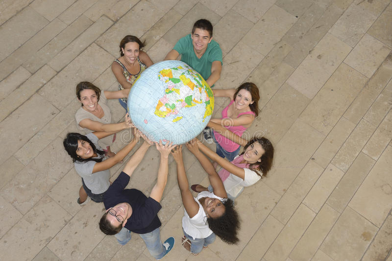 Download Group Holding  The Earth Globe Showing Africa Stock Image - Image: 26832997