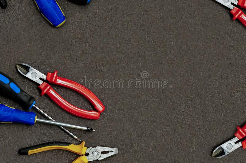 Group home repair master screwdriver black yellow pliers set of screwdrivers copy dpace on dark background mockup royalty free stock images