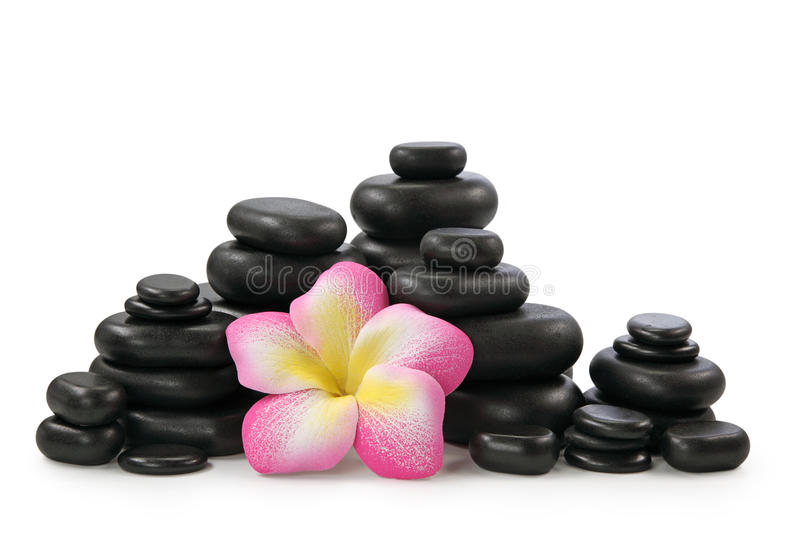 Group of hot stones and flower. On white background stock photos