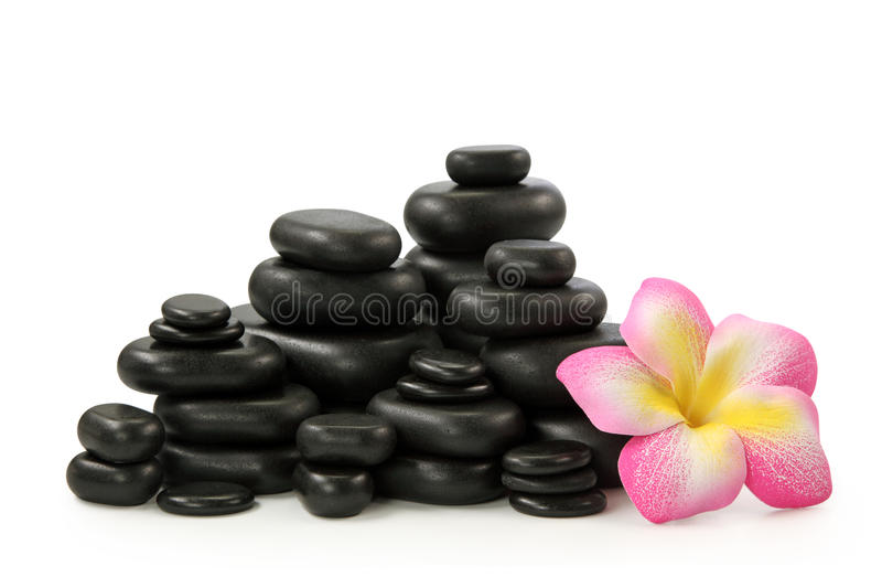 Group of hot stones and flower. On white background royalty free stock photos