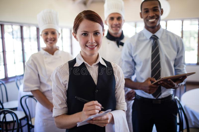Group of hotel staffs standing in hotel stock photo