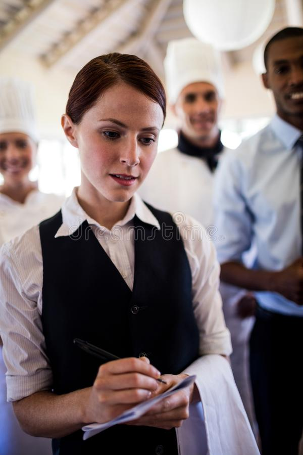 Group of hotel staffs standing in hotel stock photos