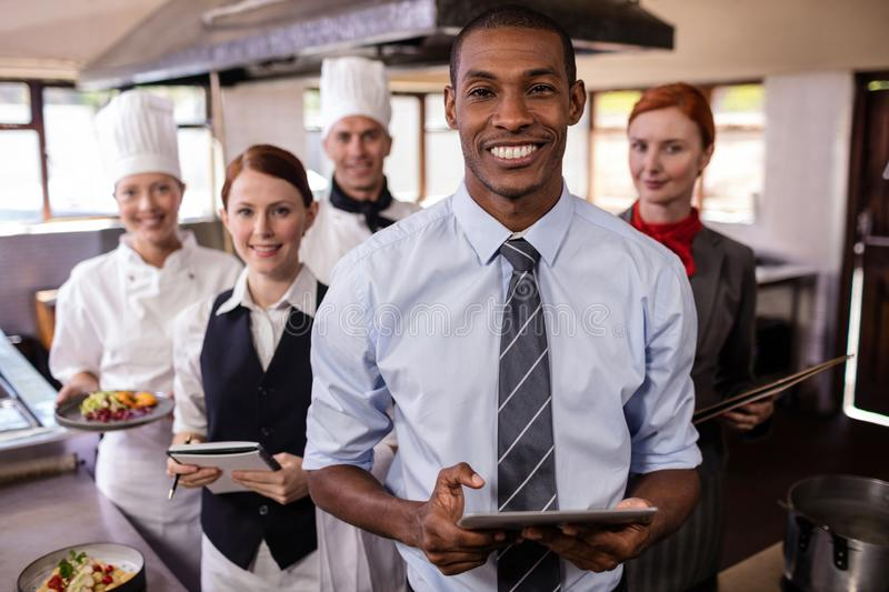 Group of hotel staffs working in kitchen royalty free stock image