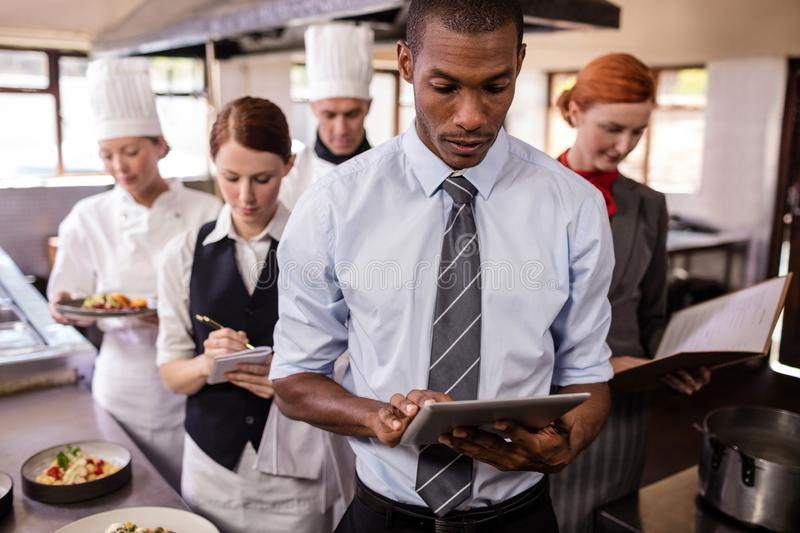 Group of hotel staffs working in kitchen stock images