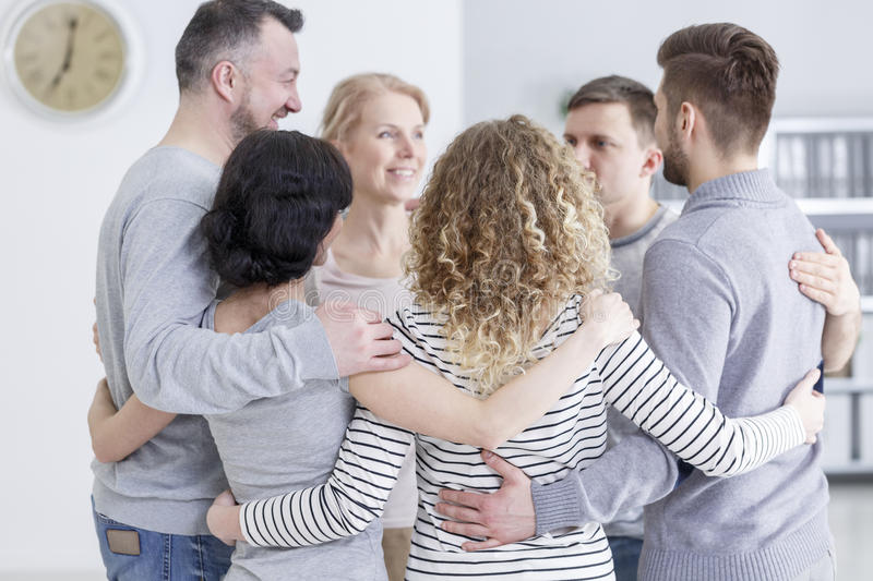 Group hug during therapy. People having group hug during therapy in rehab stock photography