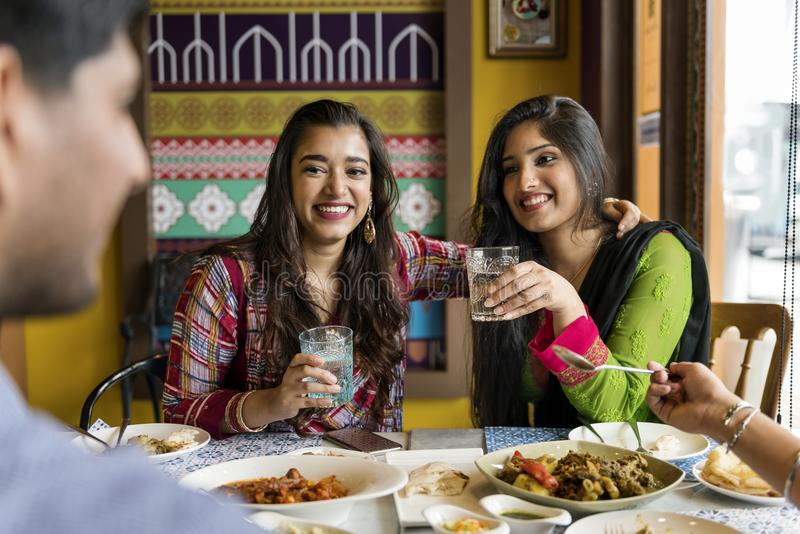 A group of Indian people is having lunch together stock photography