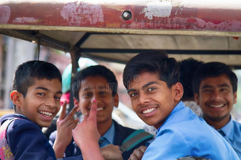 group of Indian students in a rickshaw taxi. royalty free stock photography