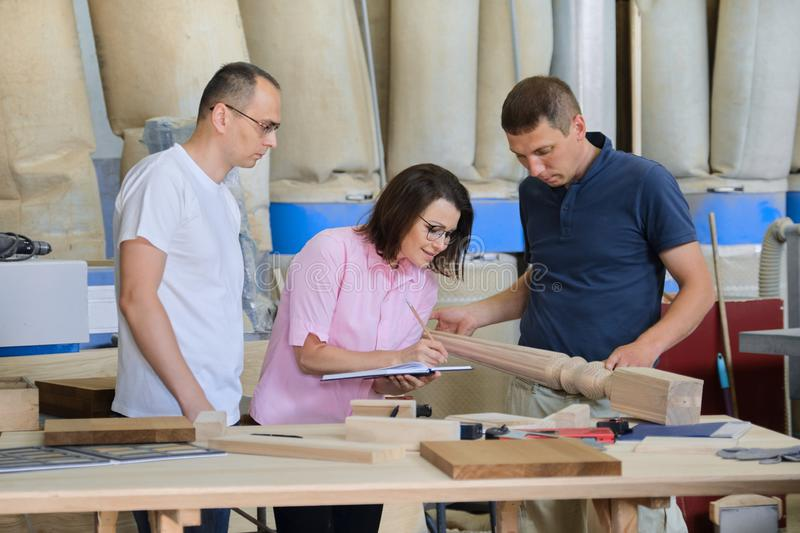 Group of industrial people working together, Teamwork in carpentry workshop. Group of industrial people client, designer or engineer and workers working together stock photography