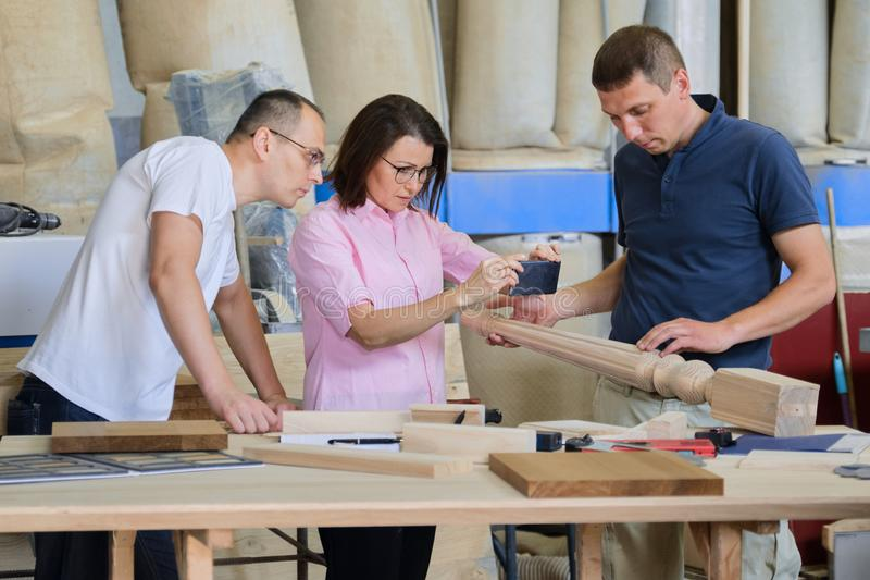 Group of industrial people working together, Teamwork in carpentry workshop. Group of industrial people client, designer or engineer and workers working together stock image