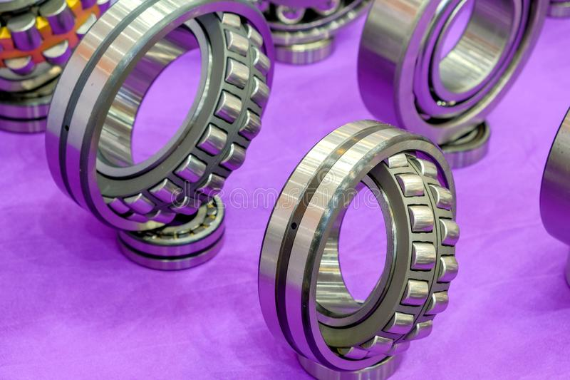 Group of industrial spherical roller bearings for use in smart factory. Close-up and selective focus a group of industrial spherical roller bearings for use in stock photography