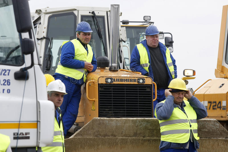 Group Of Industrial Workers Having A Rest Editorial Stock Photo