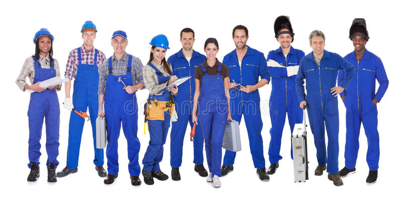 Group of industrial workers royalty free stock photos